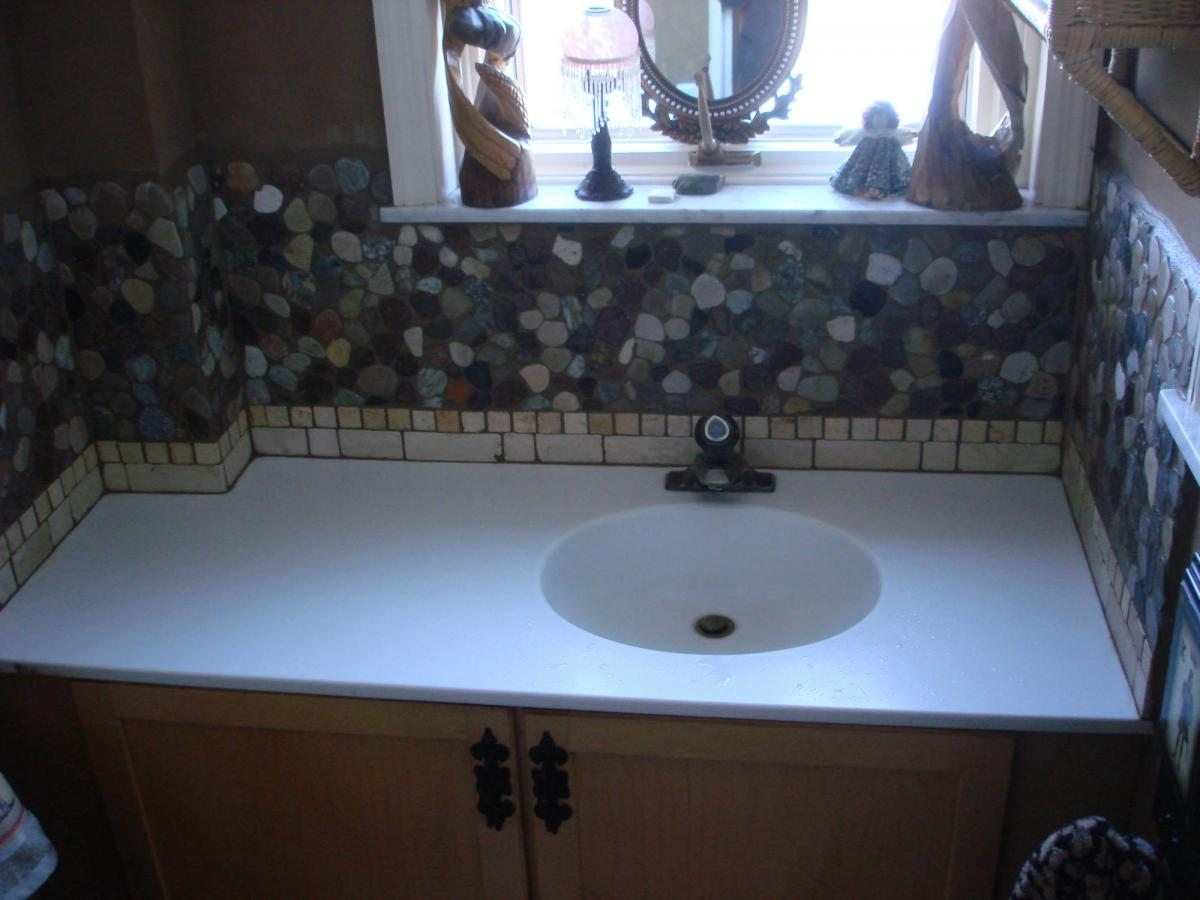 Powder room river stone backsplash new jersey custom tile