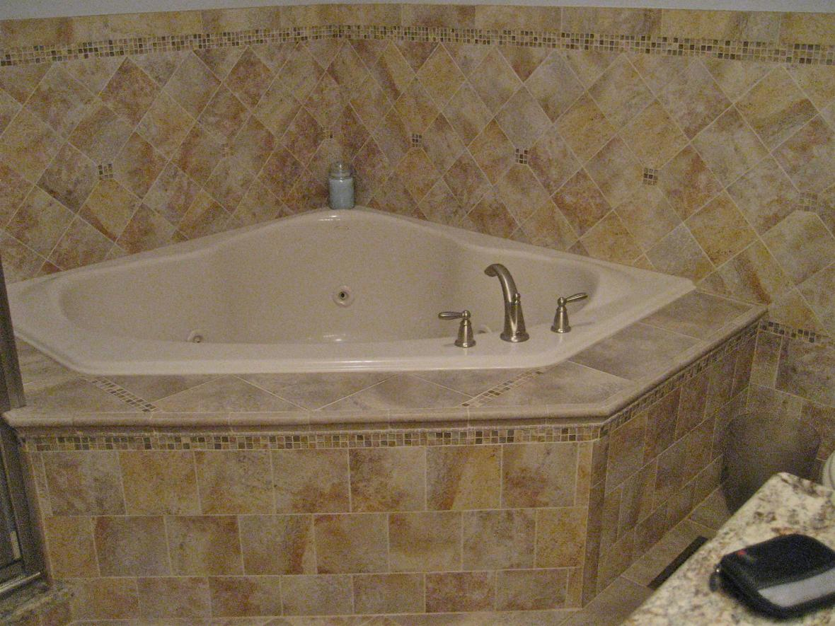 Completed bathroom with porcelain tiled jacuzzi, floor, and bathroom ...