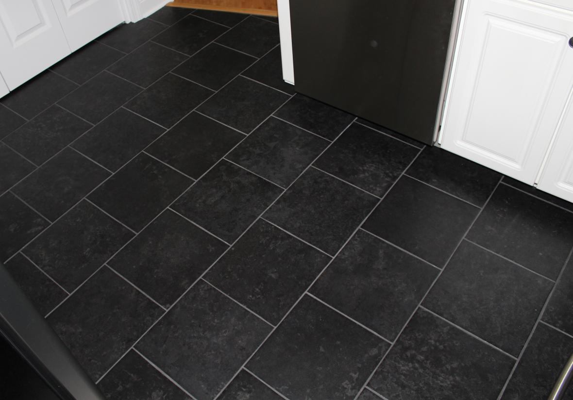 Dark Tile Flooring these dark stone tile floors create contrast with the bright white Read More About Black Tile Kitchen Floor Black Porcelain Tile Floor