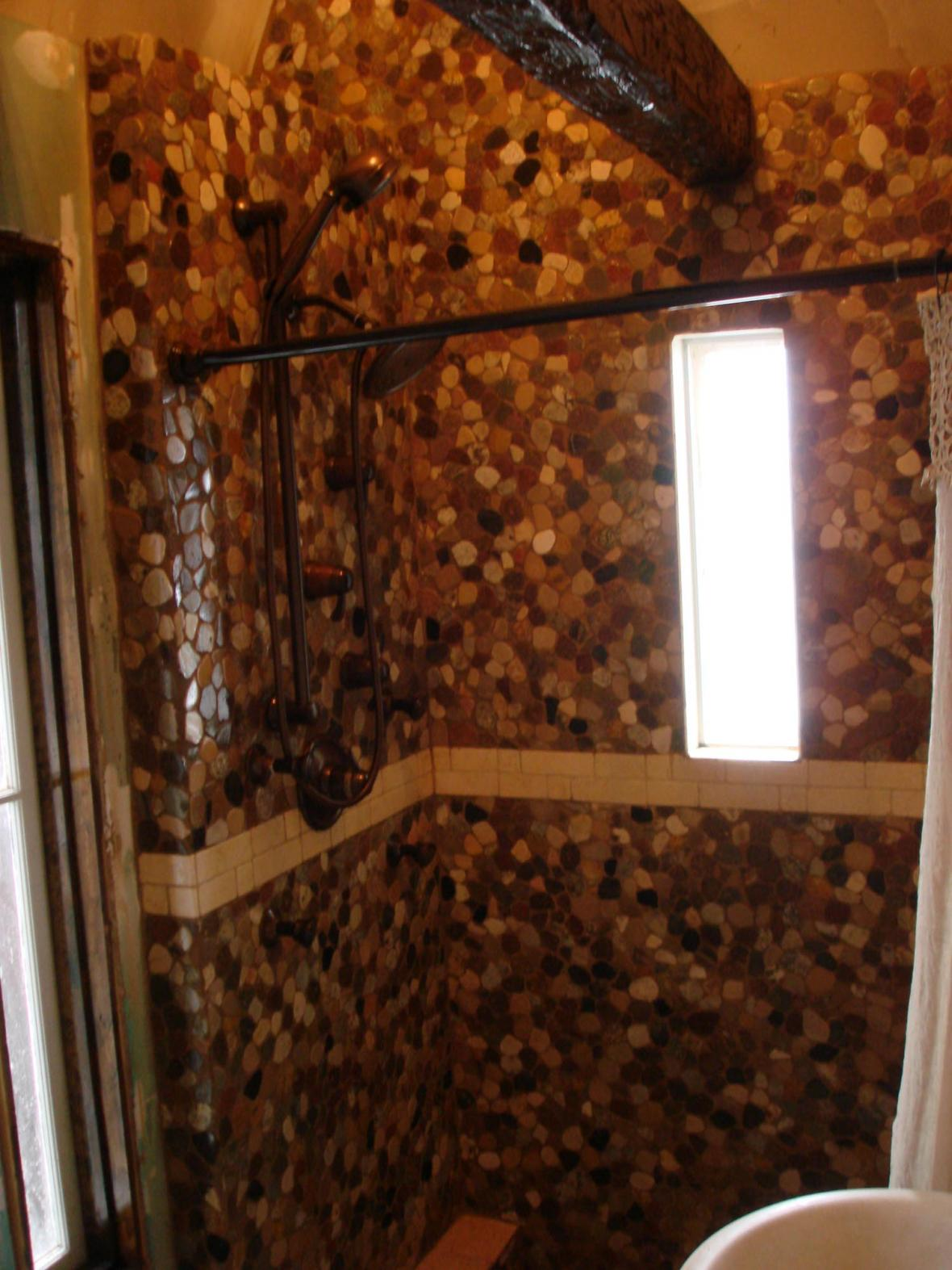 Custom river stone and tumbled marble shower