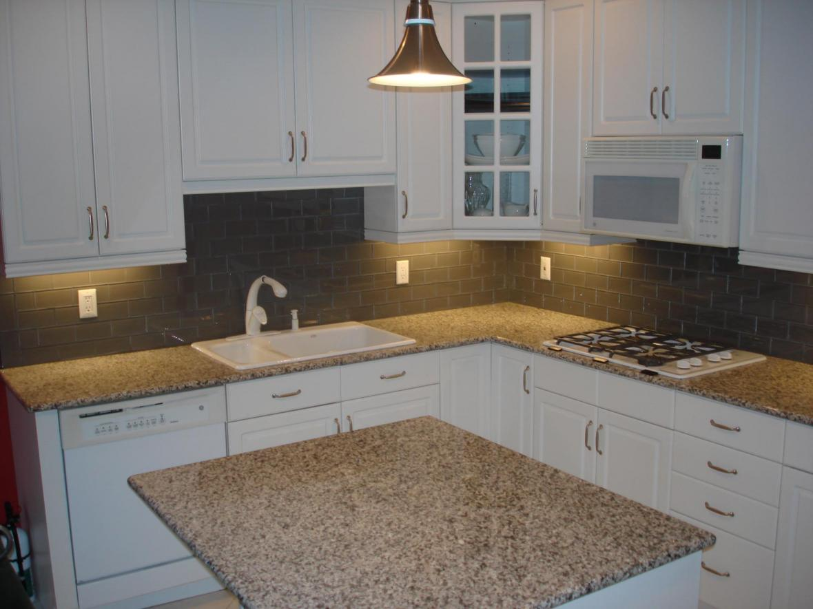 Gray glass backsplash brick pattern