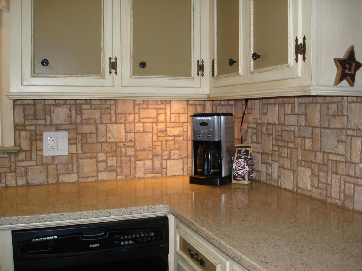 Travertine Herringbone Kitchen Backsplash With Metal Accents
