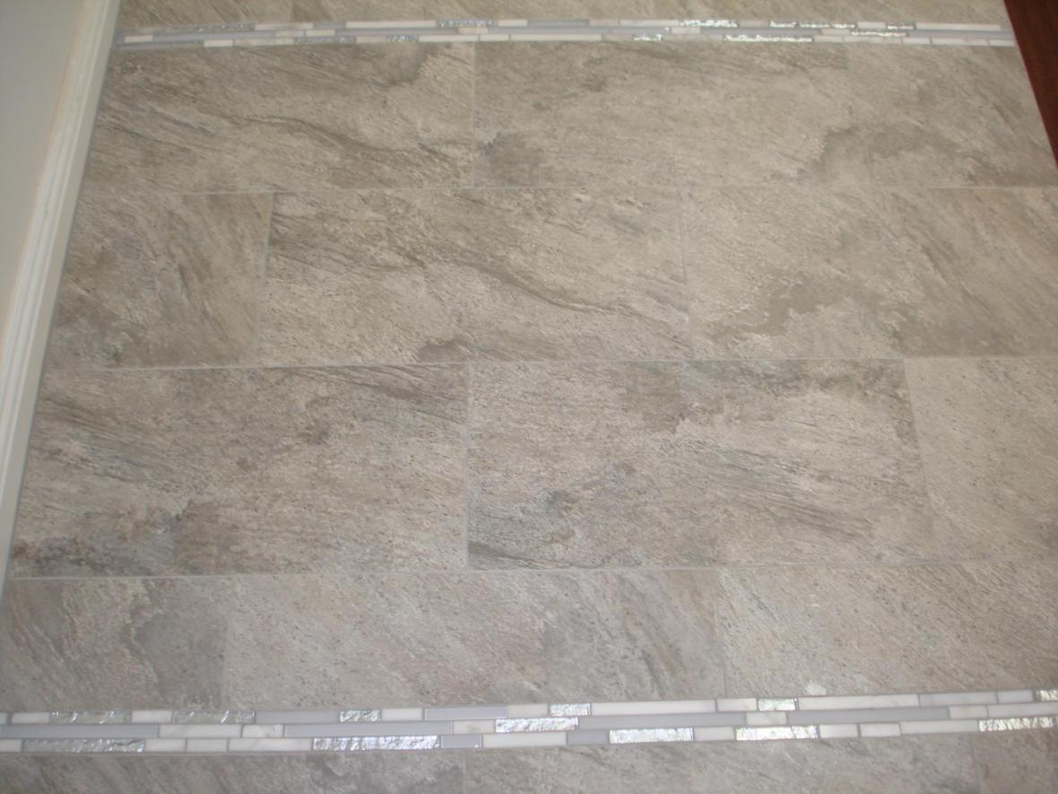 Porcelain tile with marble and glass stick accent border