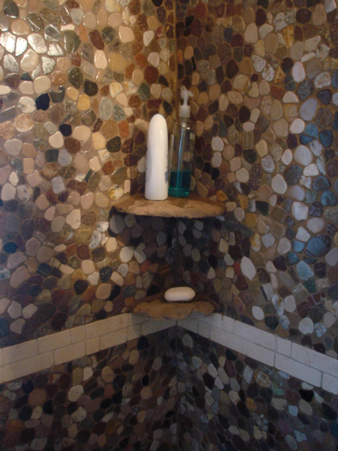 Real stone shampoo shelves in a riverstone shower