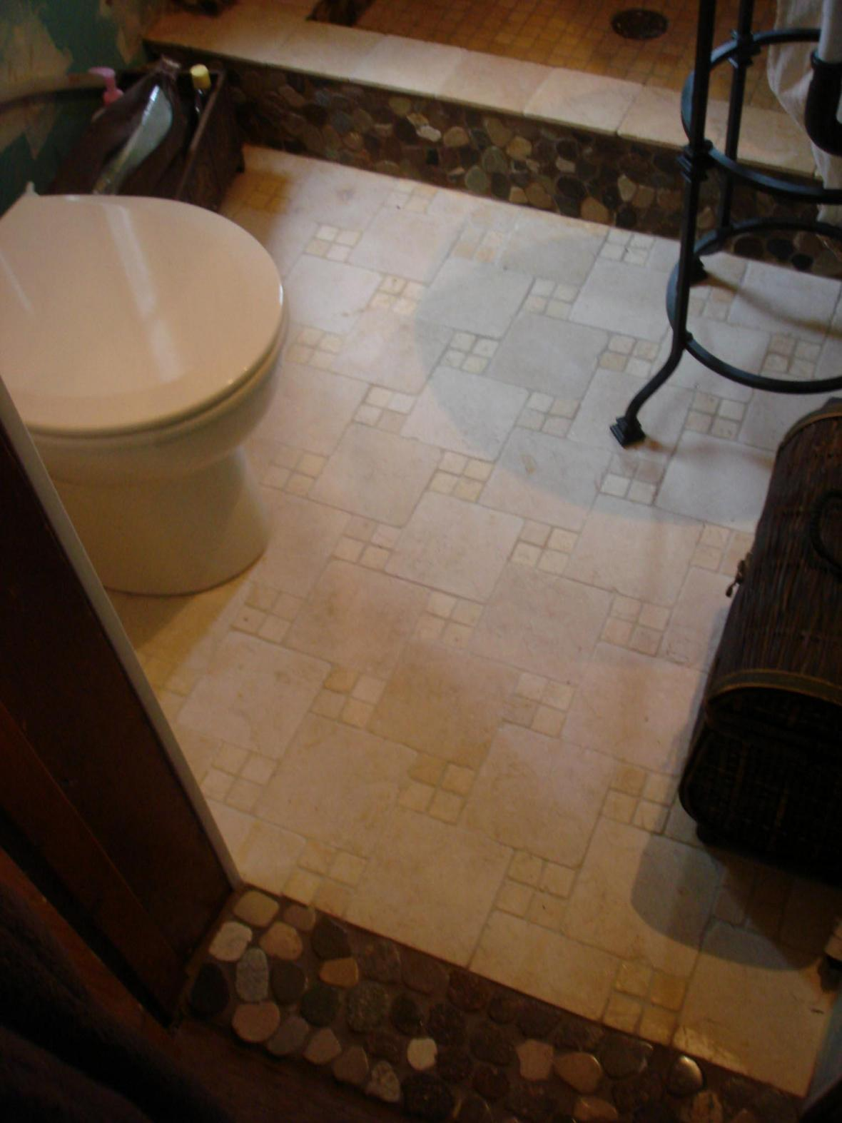 Tumbled marble bathroom floor on a pinwheel pattern