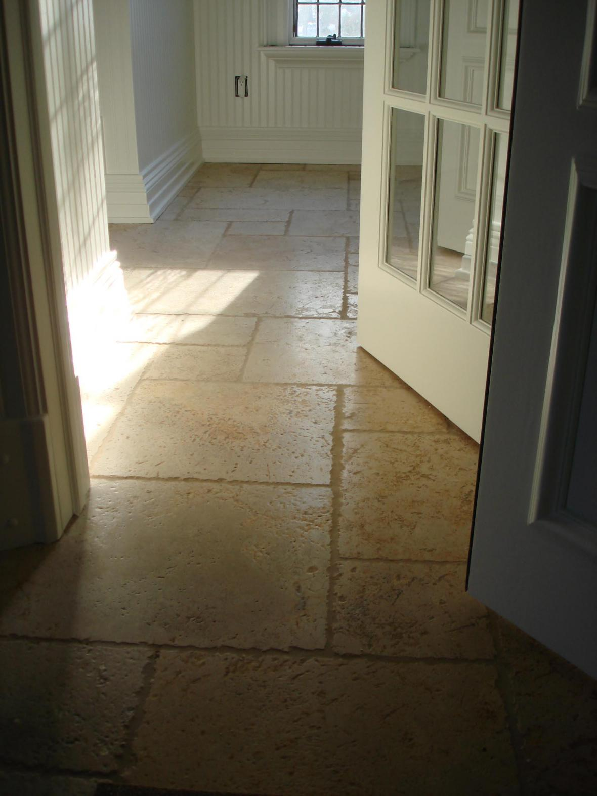 Tumbled marble floor in laundry room