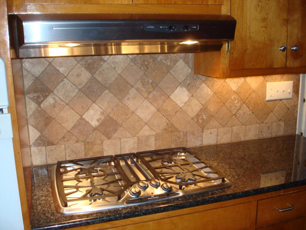 Tumbled travertine backsplash on diagonal