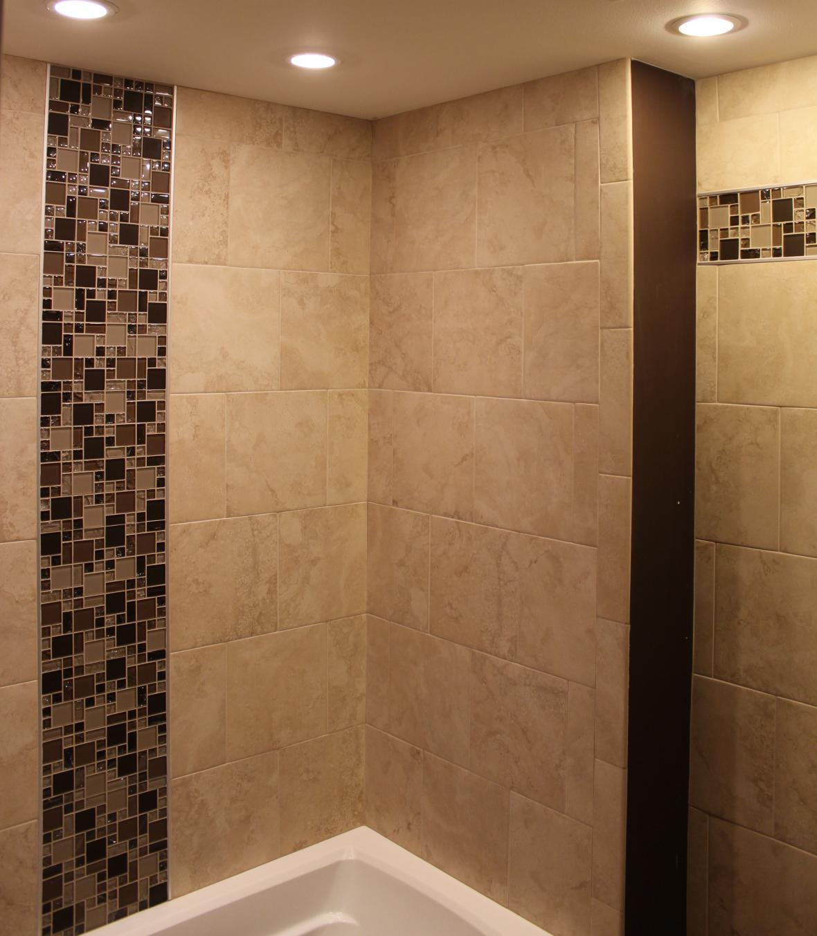 Porcelain tile shower with mosaic glass borders new for Glass tile border bathroom ideas