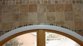 Bathroom wall tile with custom glass border