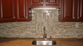 Glass and stone backsplash with accent