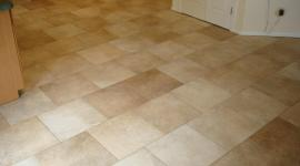 Porcelain kitchen tile floor on a brick pattern