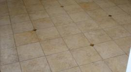 Porcelain tile floor with glass inserts