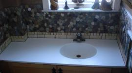 Powder room river stone backsplash