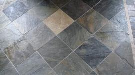 Slate tile floor with etched stone deco