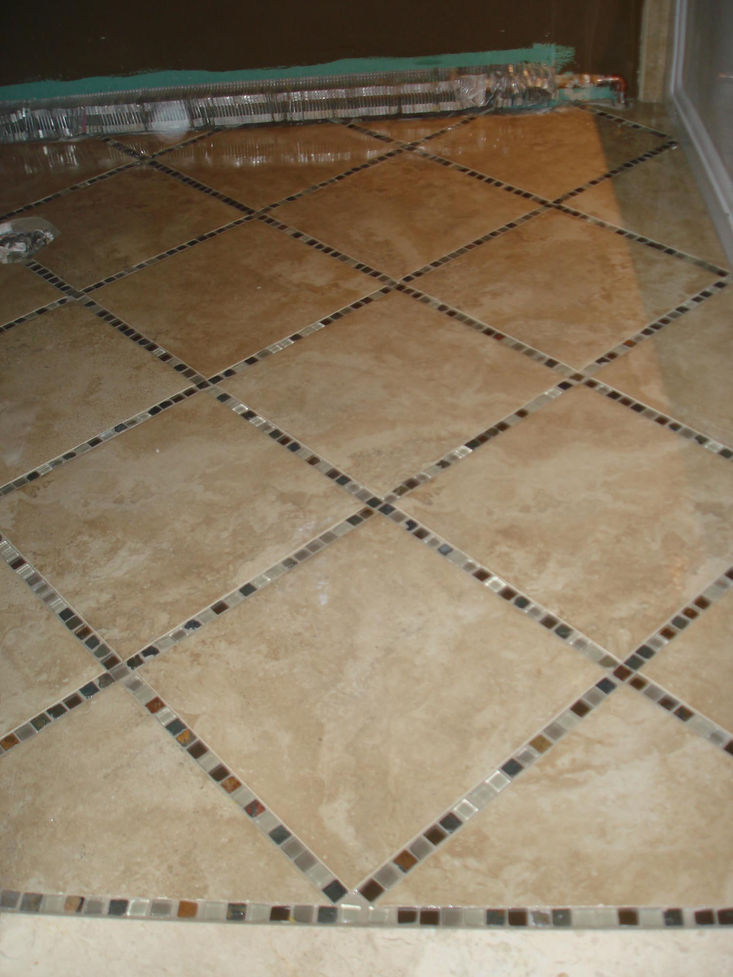 Porcelain tile floor with glass and slate inlay | New