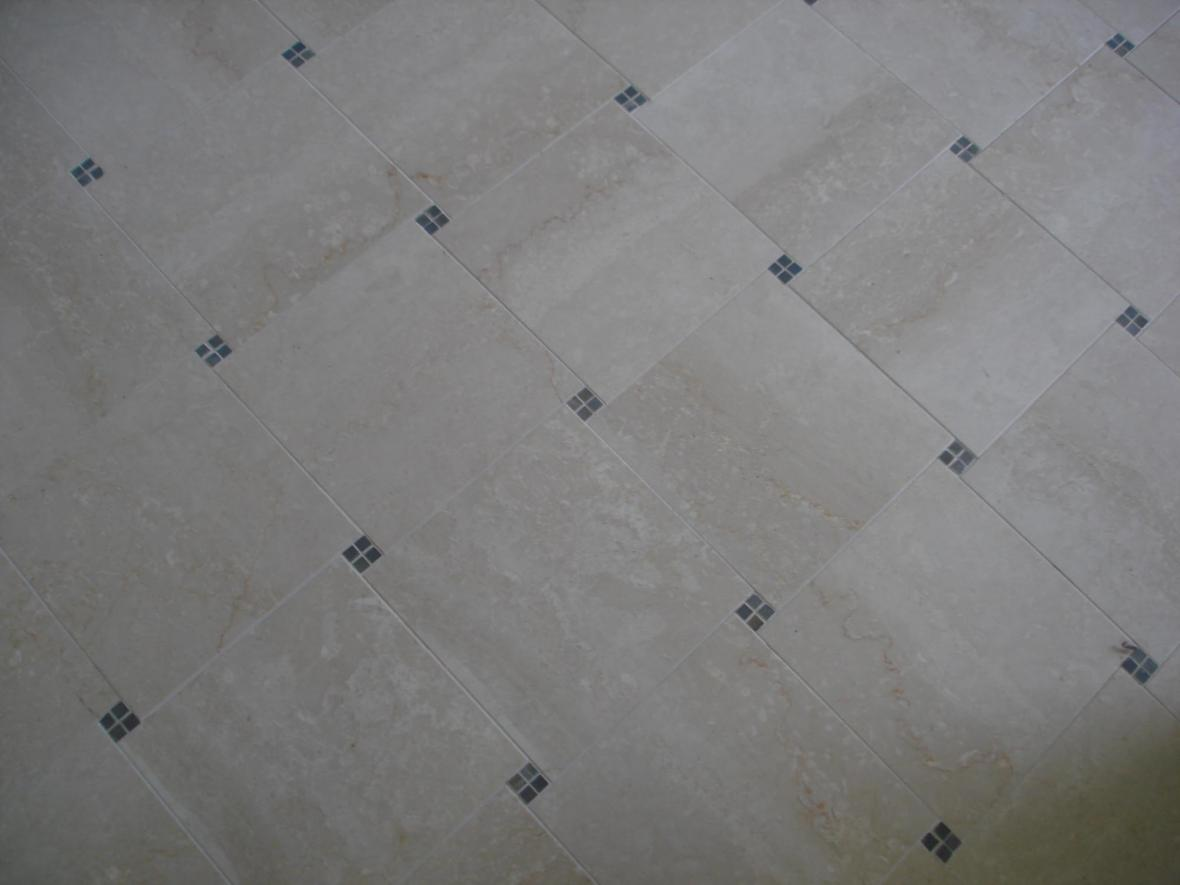 Polished marble tile floor with deco