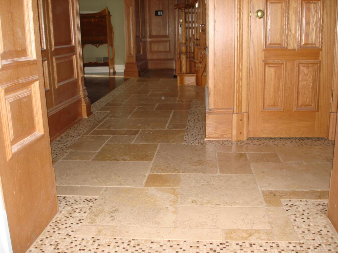Tumbled marble with marble mosaic border foyer floor